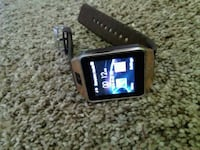 black and gold smartwatch with black strap