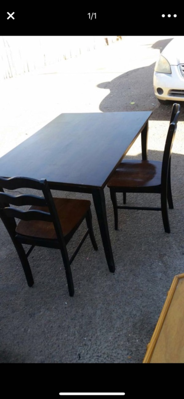 Wooden dinning table with two chairs