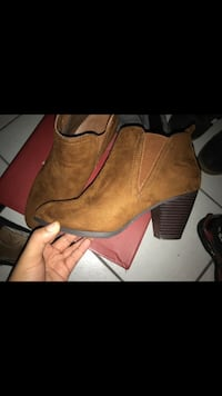 pair of brown suede cone-heeled chelsea boots