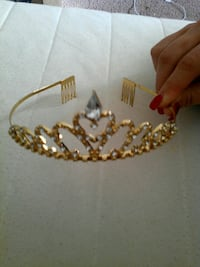 gold-colored and encrusted diamond tiara