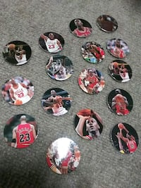 16 Michael Jordan Pogs (including four 3d holograp