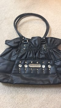 black leather studded tote bag