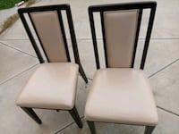 two white leather padded chairs Riverside, 92503