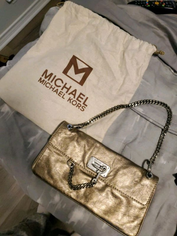 Michael Kors gold purse  0