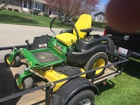 green and black zero turn mower 30 mi