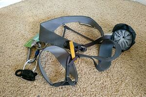 Adult climbing harness with belay device
