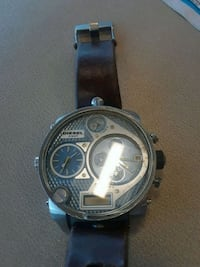 round silver chronograph watch with black leather strap Montréal, H8S 1Y5