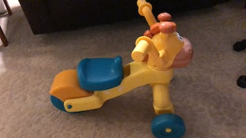 yellow and blue ride on toy