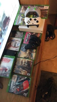 Black xbox one console with controller and game cases Port Richey, 34668