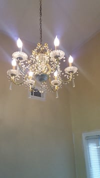 gold and white uplight chandelier