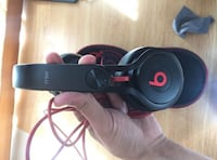 black and red Beats corded headphone