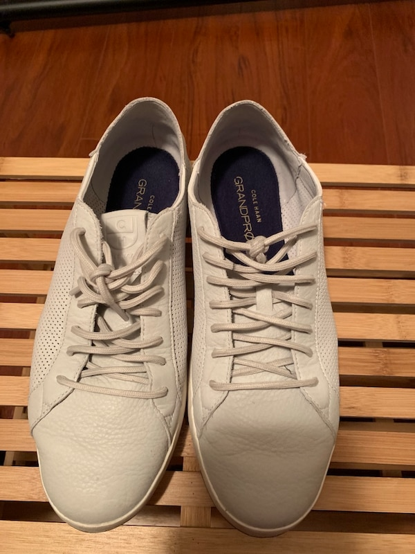 Pair of white-and-black low top sneakers