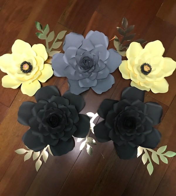 Paper flowers grey and yellow.    5f9fe046-12dc-43d4-93fa-4888bf46cfb3