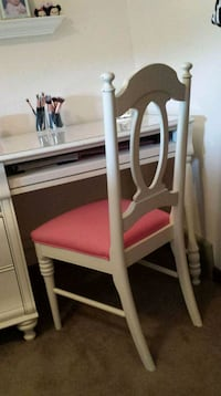 Solid white desk with pink upholstered chair Illinois