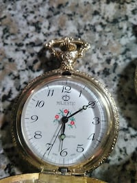 round gold-colored pocket watch Windsor, N9B 2C7