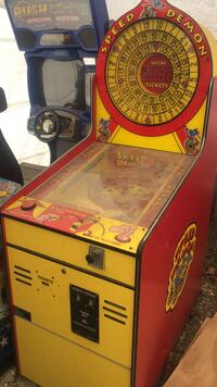 red and yellow wooden Speed Demon arcade machine Lakewood, 90715