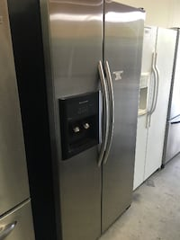 silver side-by-side refrigerator with dispenser