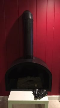 Vintage style Real flame jel metal fireplace, never used, with logs and legs to be installed, fireplace and vent pipe, a can of real flame included, for use or decorative Kenilworth, 07033