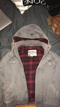 Gray and red TNA button-up jacket