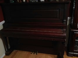Vintage upright piano in good condition.
