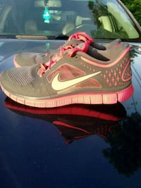 pair of gray-and-pink Nike running shoes Cedar Springs, 49319
