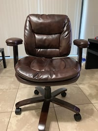 black leather padded rolling armchair Coral Springs, 33071