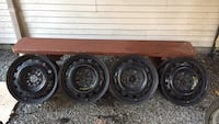 Four black bullet hole car wheels with tires Pitt Meadows, V3Y 2G9
