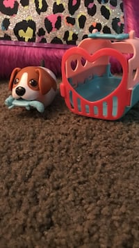 pink, red, and blue plastic pet carrier toy with white and brown dog toy Richardson, 75080