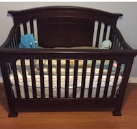 Solid dark wood crib