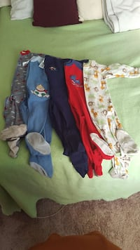 five white, red, blue, teal, and gray onesies