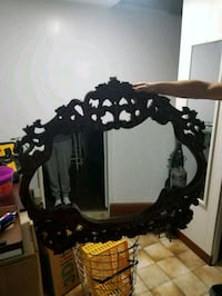black wooden frame wall mirror