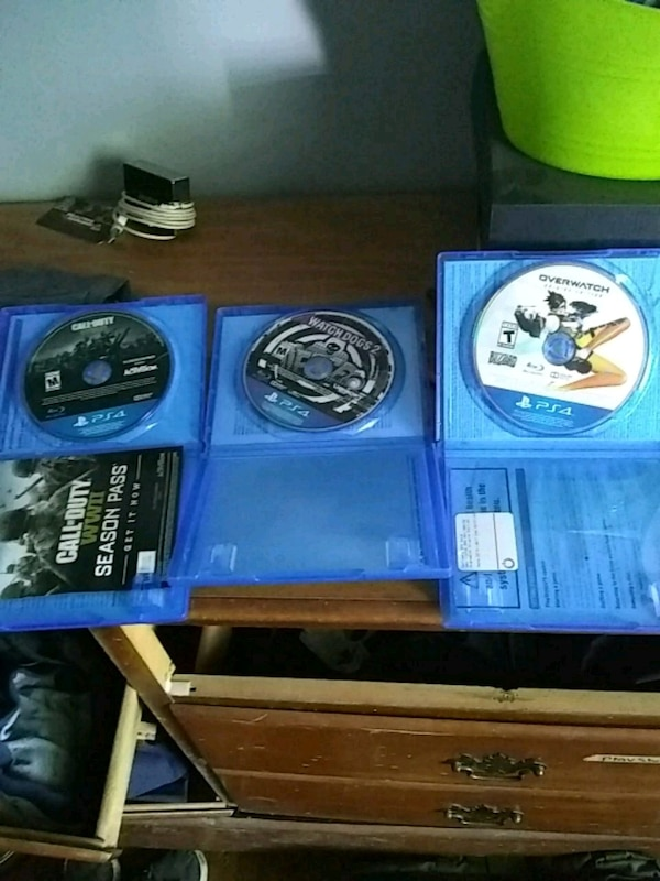 three assorted PS4 game discs
