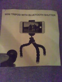 Mini tripod with Bluetooth shutter fits most cell
