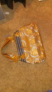 yellow and gray floral leather tote bag