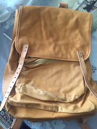 Great quality leather knapsack never used, great comfy pack with drawstrings and waist belt  722 km