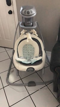 Baby's white and gray cradle and swing Tampa, 33618