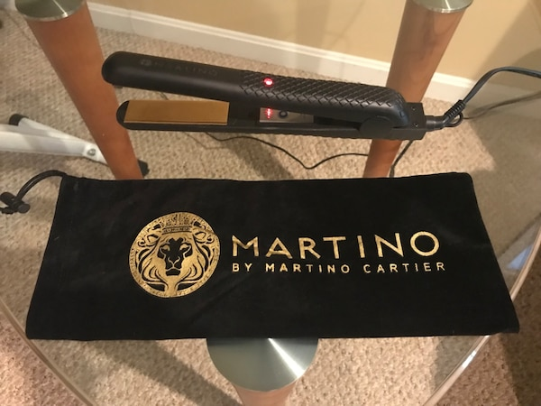 Martino flat iron with adjustable heat setting. Purchased from HSN.com for $99.  Used very little.