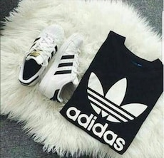 White and black Adidas Superstar \