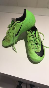 pair of green Nike cleats 545 km