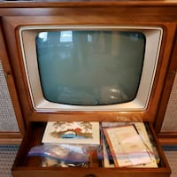 gray CRT television with brown wooden TV hutch Calgary, T3M 1H8