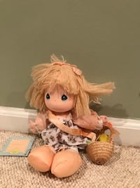 brown haired female doll in white dress