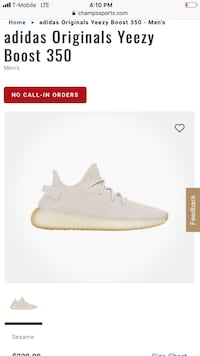 unpaired white Adidas Yeezy Boost 350 V2 1386 mi