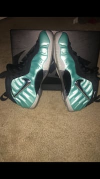Pair of teal nike foamposite pro shoes 25 km