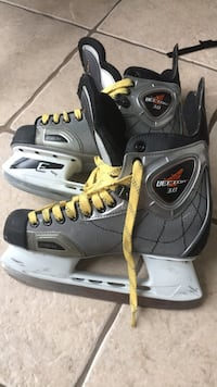 Pair of gray-and-black bauer ice skates Brossard, J4Y 0C8