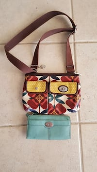 teal leather long wallet and yellow, white, and green floral leather crossbody bag