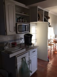 White and black wooden kitchen cabinet
