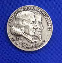 Anniversary of Maryland 350 th 1634-1984 Cecil and George Calvert silver coin Mint condition .273.4 total weight Baltimore, 21205