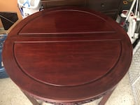 Dining set with five chairs.  One captain's chair is missing. Can be ordered from original site   Ormond Beach, 32174