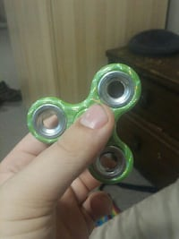 green and black fidget spinner 539 km