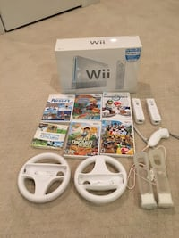 white Nintendo Wii console with controller and game cases Fairfax Station, 22039
